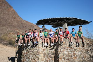 Rams Cycling Team Sitting on a Ledge